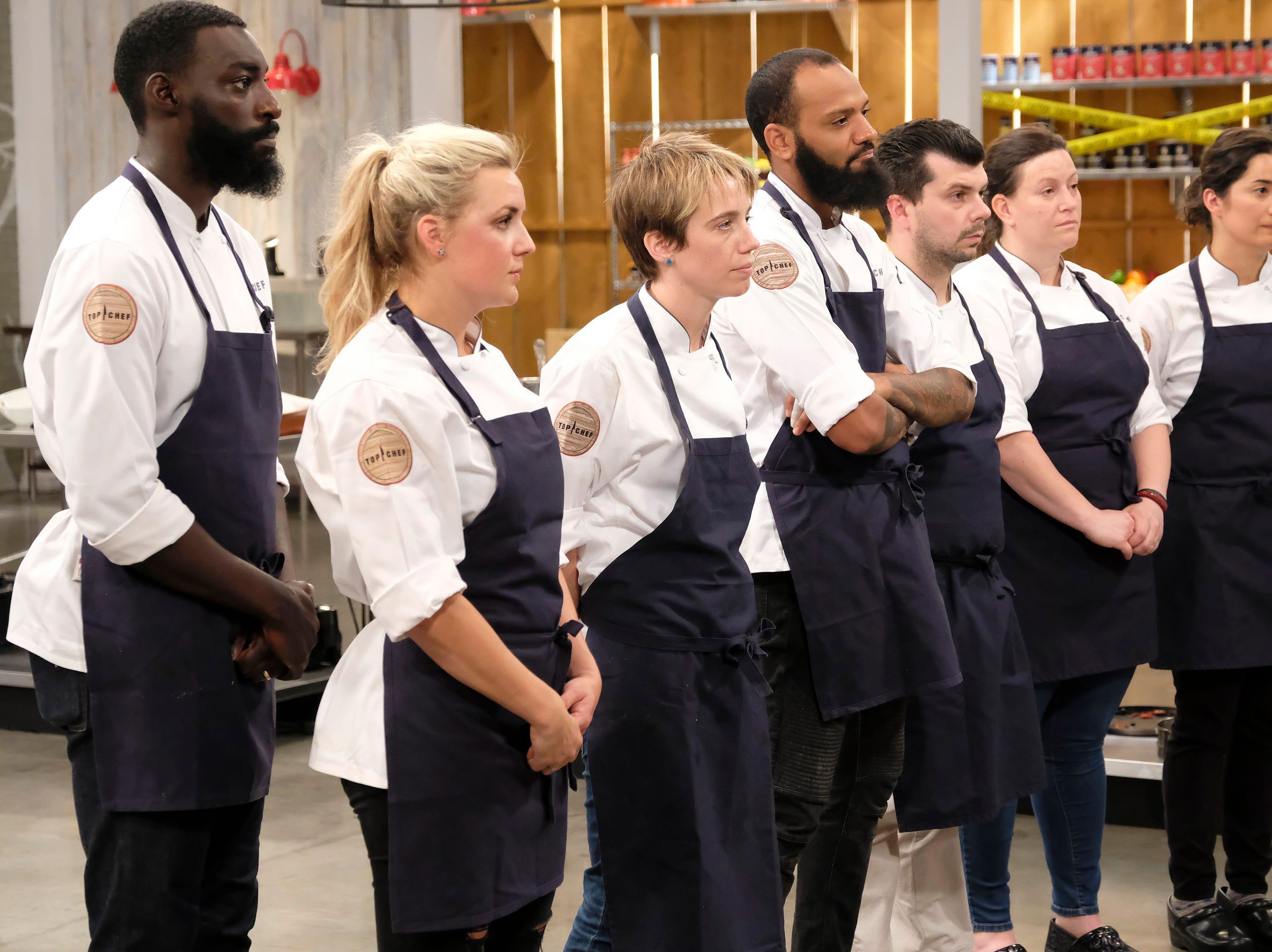(From left to right): Contestants Eric Adjepong, Kelsey Barnard, Adrienne Wright, Justin Sutherland, Eddie Konrad, Sara Bradley and Michelle Minori on episode 10 of Bravo's 'Top Chef: Kentucky' season.