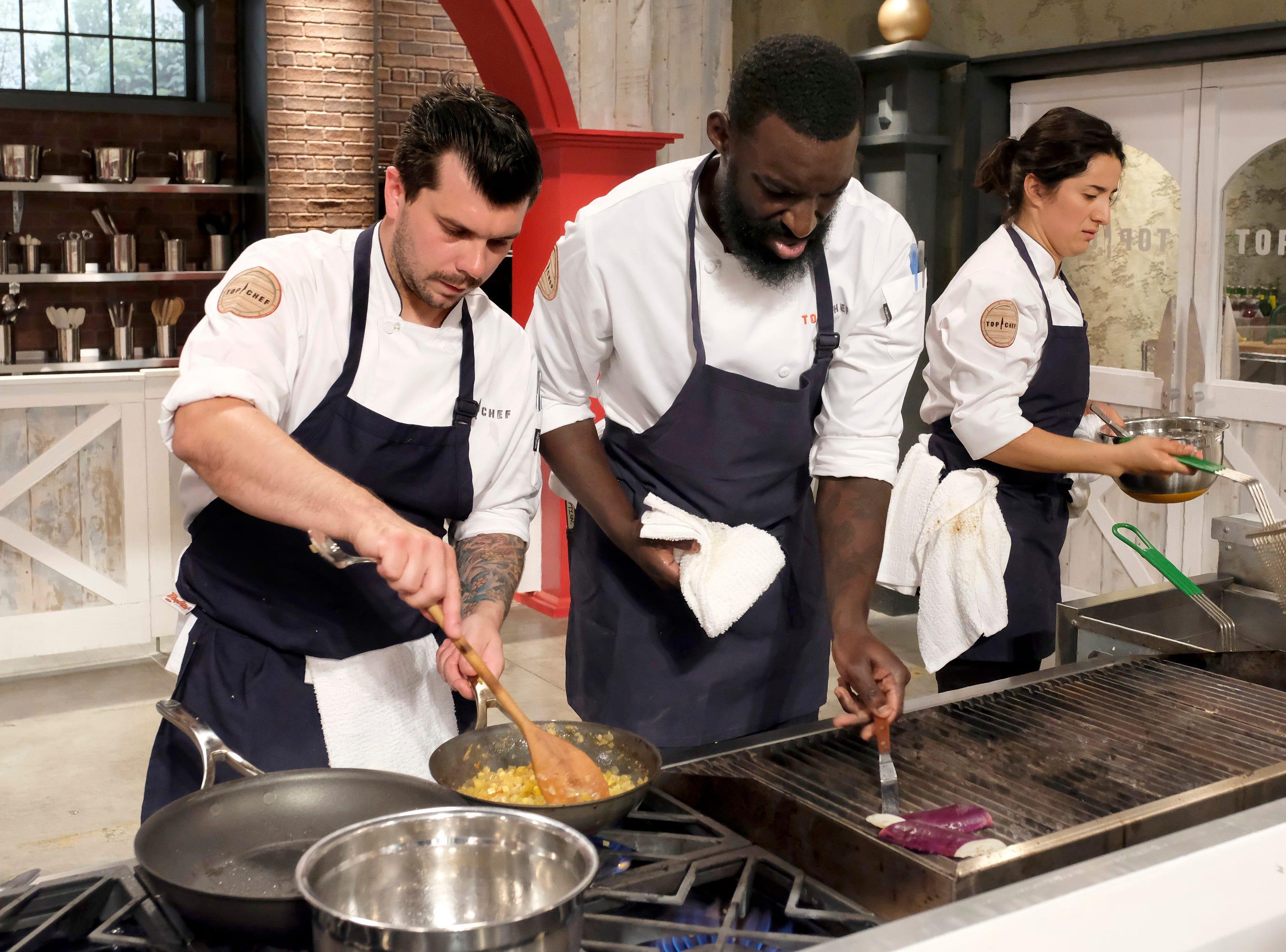 (From left to right): Contestants Eddie Konrad, Eric Adjepong and Michelle Minori on episode 10 of Bravo's 'Top Chef: Kentucky' season.