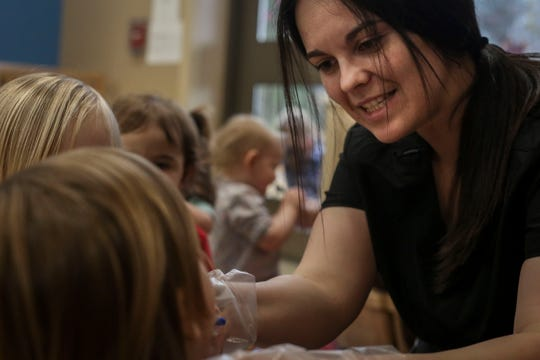 Stephanie Wright, primary caregiver, right, helps children brush their teeth during the Early Head Start program at Brooks Elementary School in Brooks, Kentucky, on Feb. 5, 2019.