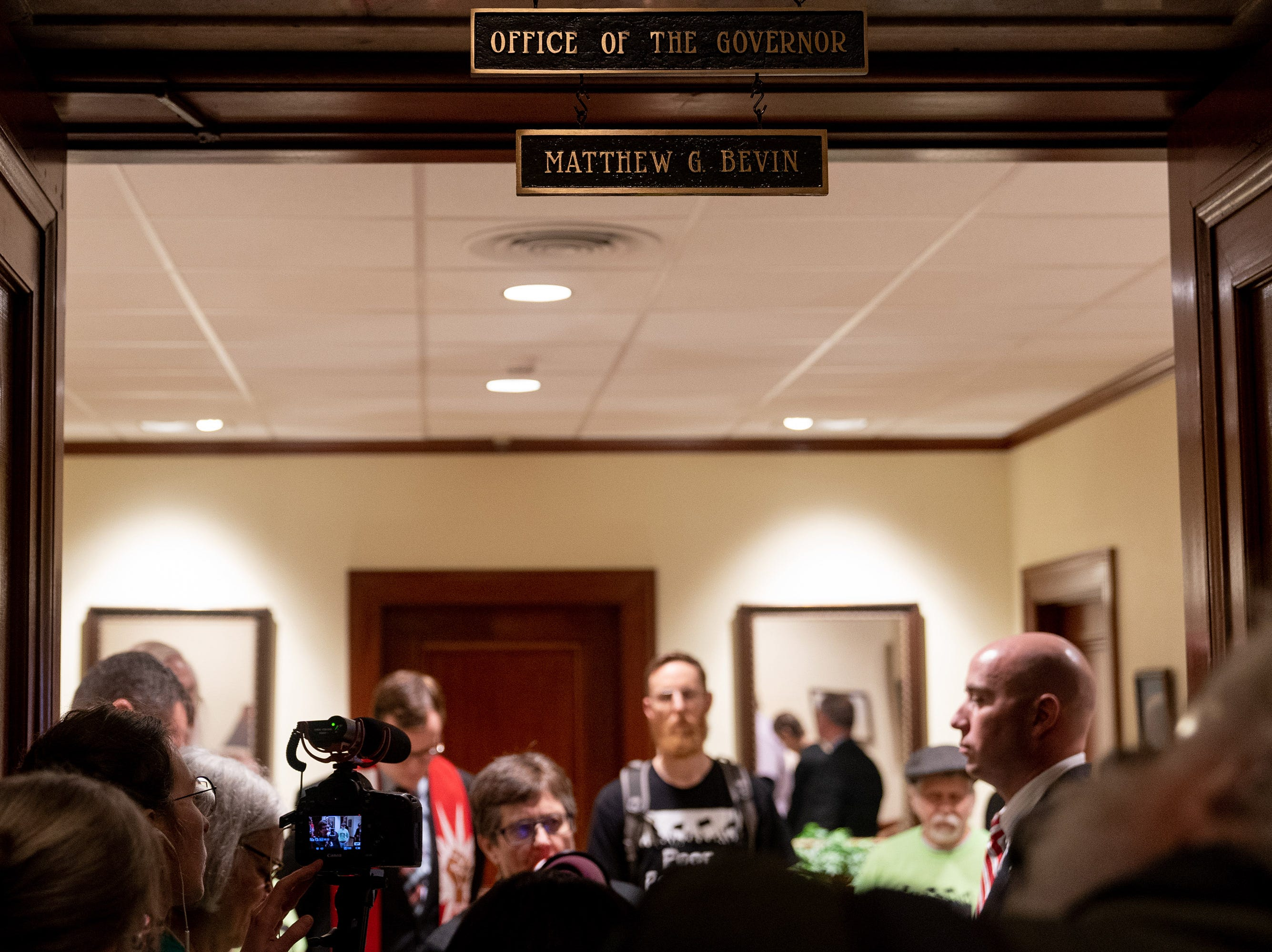 Members of the Kentucky's Poor People's Campaign gather and refuse to leave the office of Governor Matt Bevin in the capital building in Frankfort, Ky, Tuesday, Feb. 5, 2018.  The group left after the Governor agreed to meet with the group later that afternoon.