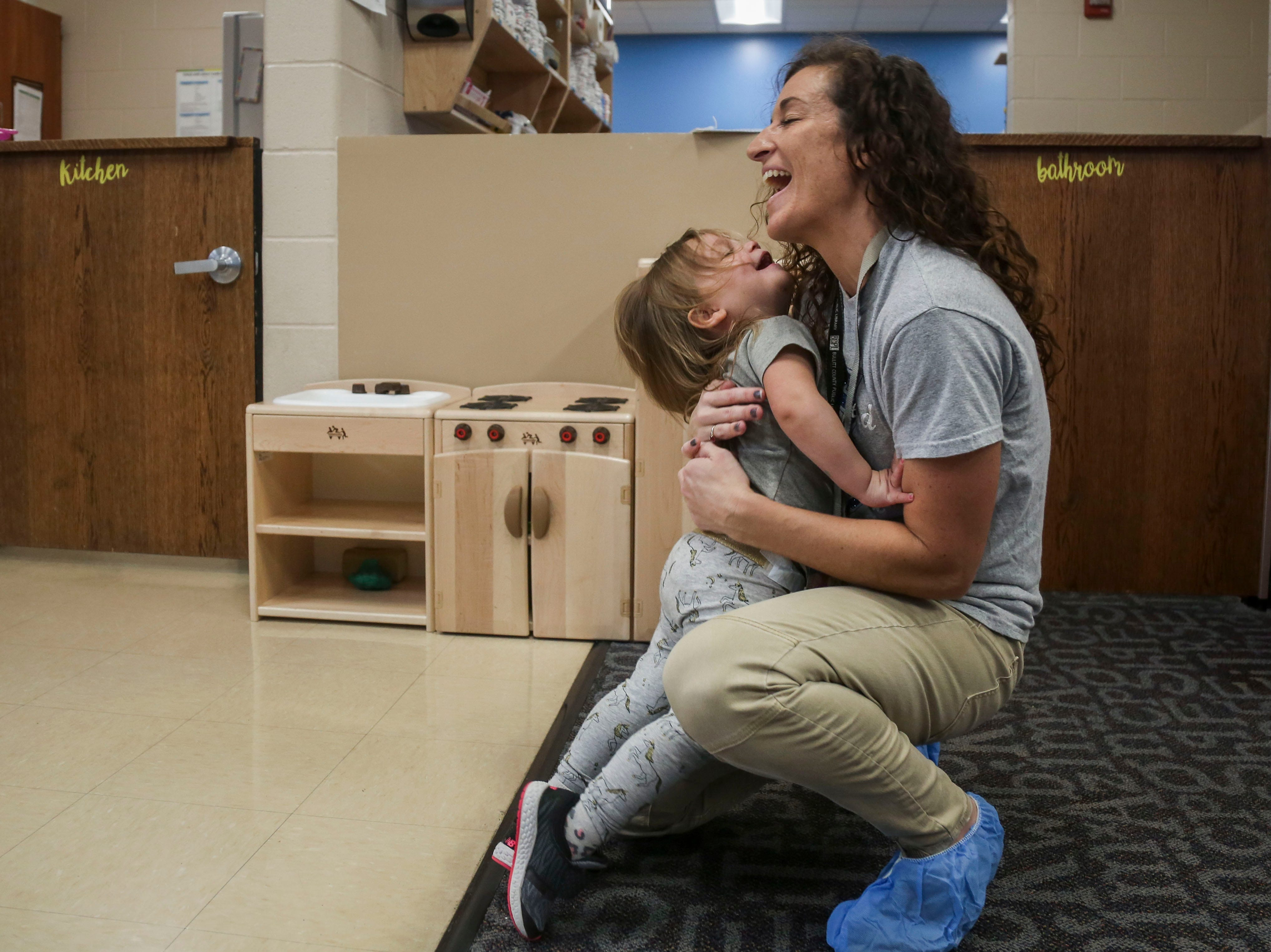 Chloe Dupree runs into the arms of Gabriella Greenwell, Instructional and Family Services Manager of OVEC Bullitt County Head Start/Early Head Startt, in the Early Head Start program at Brooks Elementary School in Brooks, Ky. on Feb. 5, 2019.