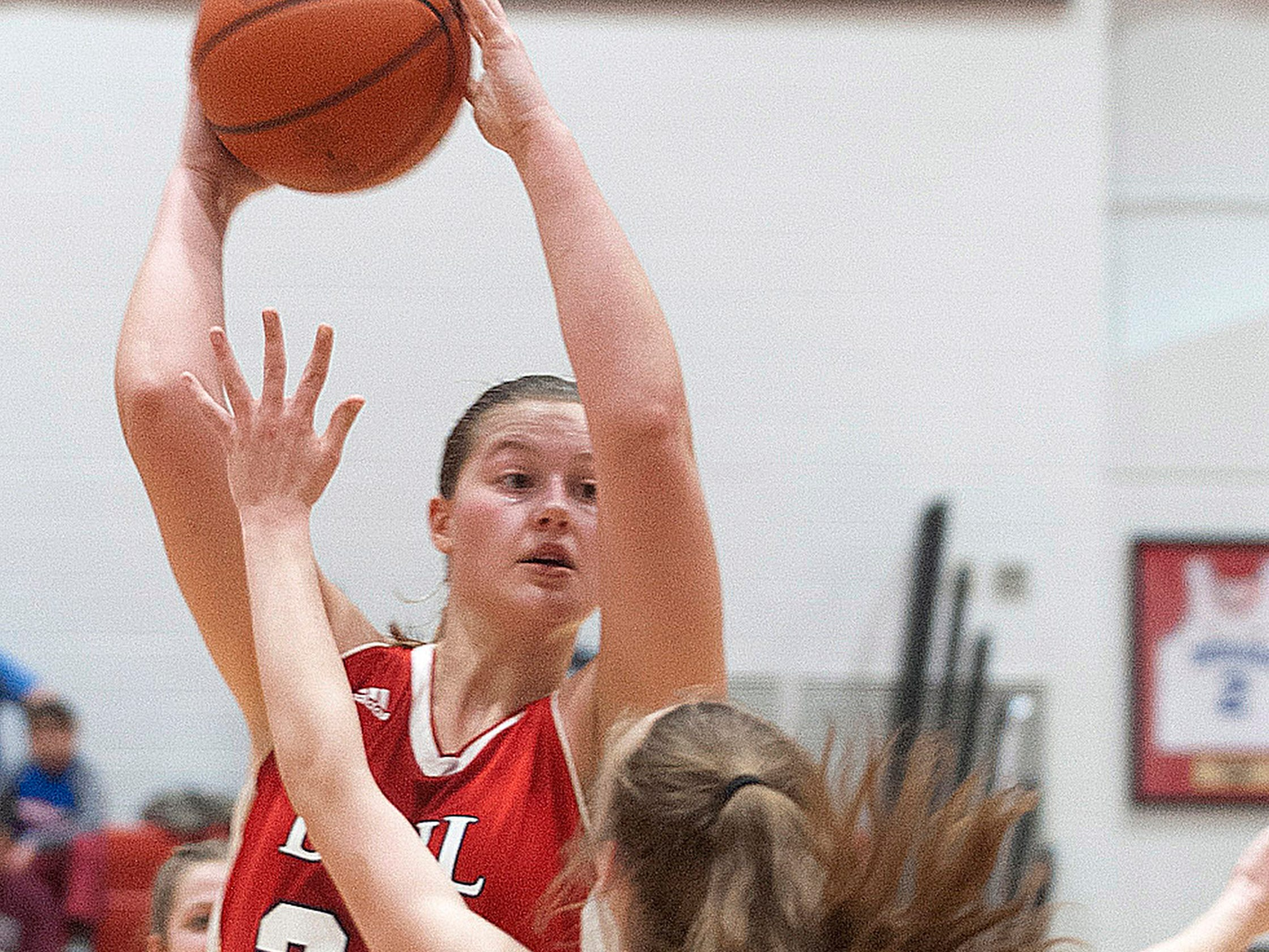 Bedford North Lawrence forward Jorie Allen puts a hot up over Jennings County guard Kali Thompson in the IHSAA New Albany Sectional Championship. BNL won the contest 56-34 with the help of Allen's team-high 17 points.05 February 2019