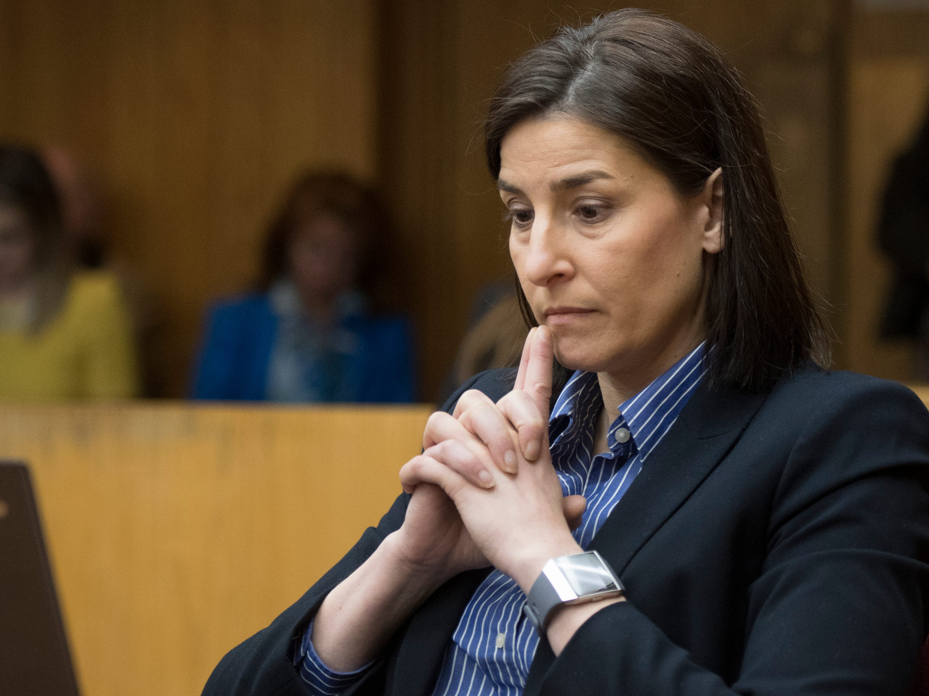 Assistant Attorney General Christina Grossi listens to opening arguments in District Judge Julie Reincke's courtroom, Tuesday, Feb. 5, 2019, during the first day of former MSU President Lou Anna Simon's preliminary hearing in Charlotte, Michigan.  Simon faces four charges, including two felonies, because investigators say she lied to police about when she knew about a sexual assault report against former MSU doctor Larry Nassar.  