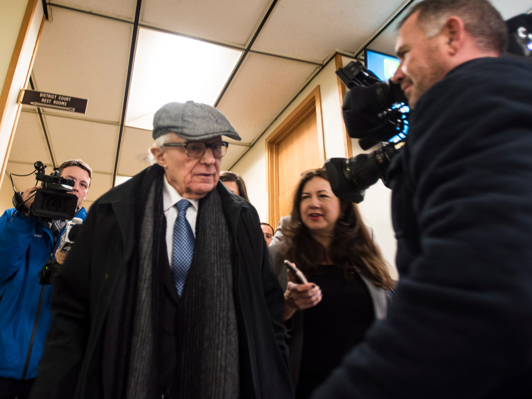 Journalists fire questions at attorney Mayer Morganroth, Tuesday, Feb. 5, 2019, after the the first day of the preliminary hearing for former MSU president Lou Anna Simon in Charlotte, Michigan.  [MATTHEW DAE SMITH/USA Today Network/Lansing State Journal]