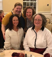 Clockwise from top left: Jean Mumma, Meghan Pineda, Doreen Bowerman and Debbie Gordon of Wind Beneath Your Wings home-care agency in Lansing at the Tri-County Office on Aging annual fundraiser.