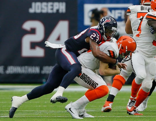 Kevin Hogan of the Cleveland Browns is sacked by Kurtis Drummond of the Houston Texans in the fourth quarter at NRG Stadium on October 15, 2017 in Houston, Texas.