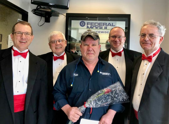 The Clipper City Chordsmen's singing Valentines come complete with roses.