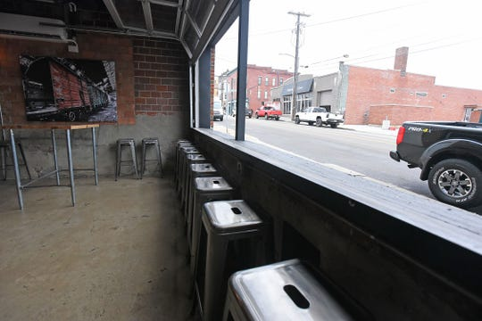 The Warehouse Tavern has a unique set of garage doors that can be opened for bar-style seating with a view of Fourth Street.