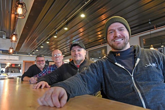 The owners of the new Warehouse Tavern are, front to back, Michael Zellner, Tom Zellner, John Campbell and Rod Zellner. They plan to open their new establishment sometime in March.