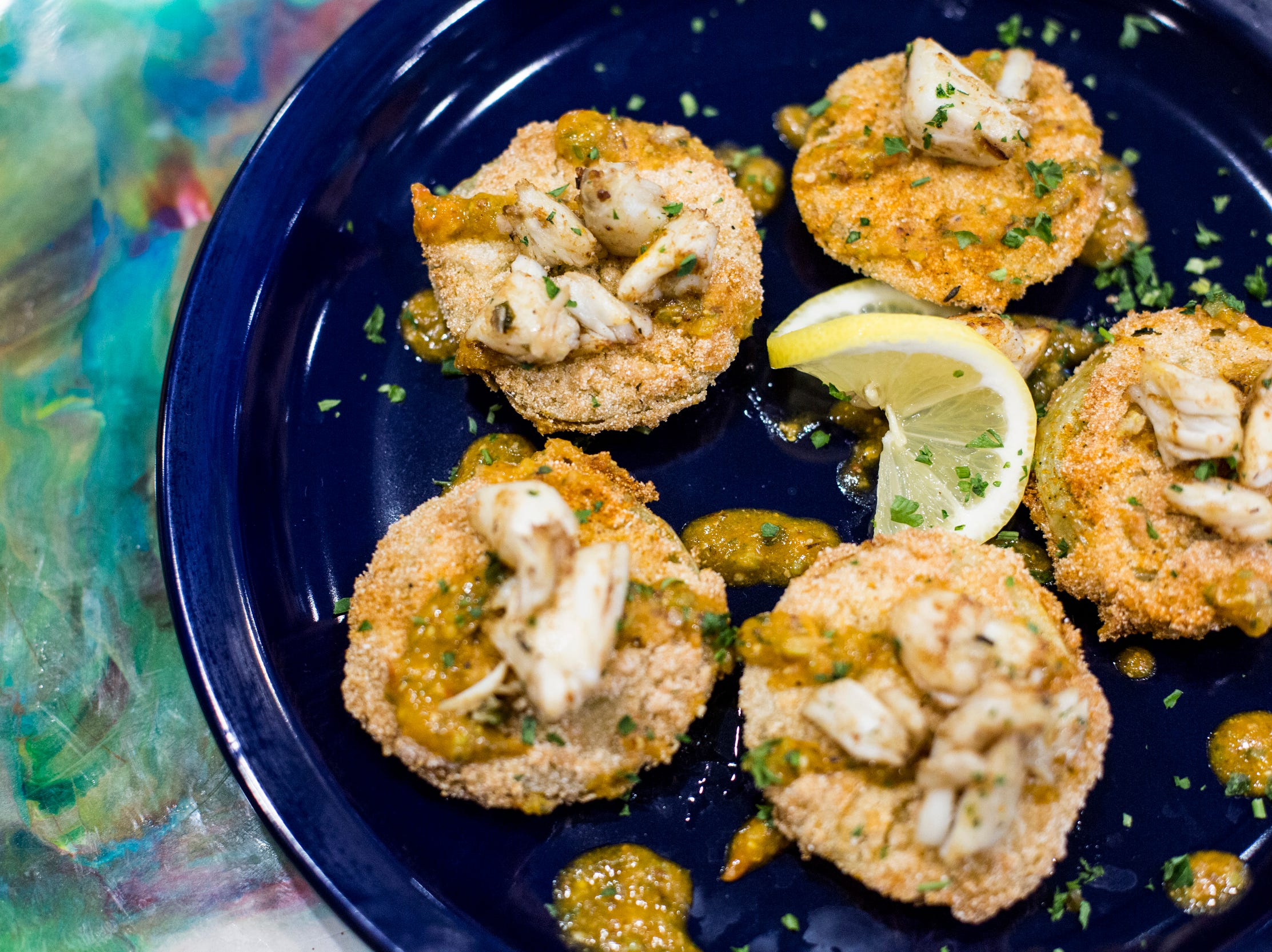 Fried green tomatoes featuring garden fresh green tomatoes hand-dipped and fried golden brown and topped with crab meat and remoulade are available at Elwood's Shells. Elwood's Shells is at 916 S. Cooper St.