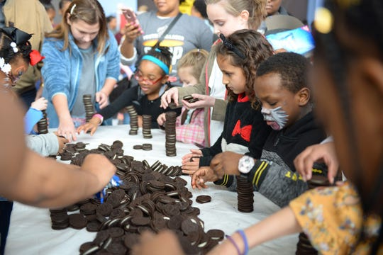 Youth Villages Soup Sunday is a family event, with activities such as Oreo stacking contests for children.