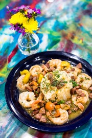 A shrimp and grits dish featuring jumbo Gulf shrimp, slow-cooked andouille sausage and smoked plum tomatoes over classic stone ground cheese grits is available at Elwood's Shells. Elwood's Shells is at 916 S. Cooper St.