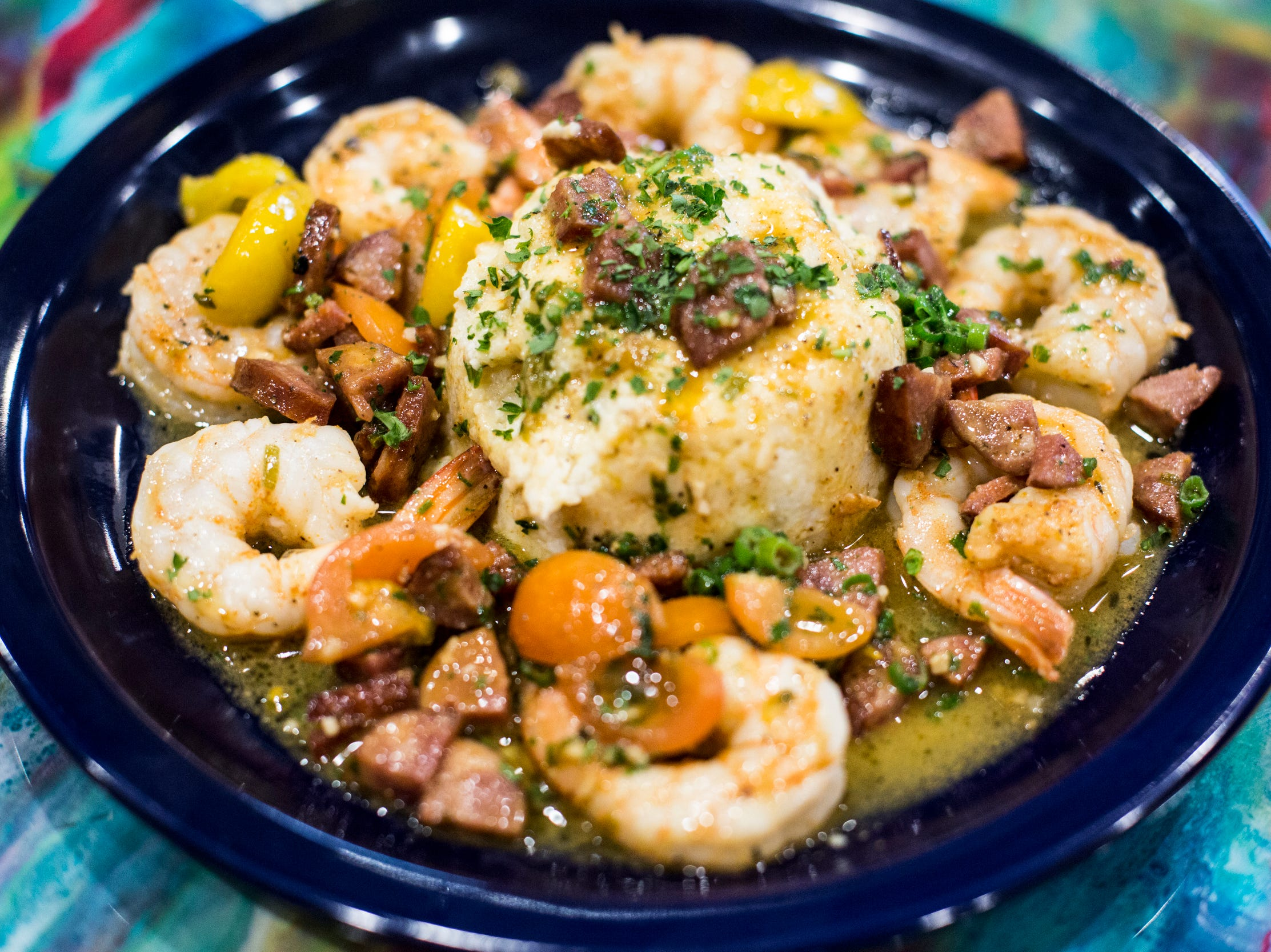 February 04 2019 - Shrimp and grits featuring jumbo gulf shrimp, slow cooked andouille sausage and smoked plum tomatoes over classic stone ground cheese grits is available at Elwood's Shells. Elwood's Shells is located at 916 S. Cooper Street.