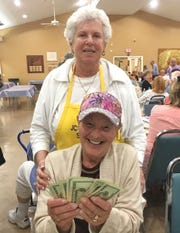 Mary Triearick, with Bingo Committee member Shirley Posner, was the big winner at JCMI's Monday Night Bingo held every week at the Jewish Congregation of Marco Island, 991 Winterberry Drive.