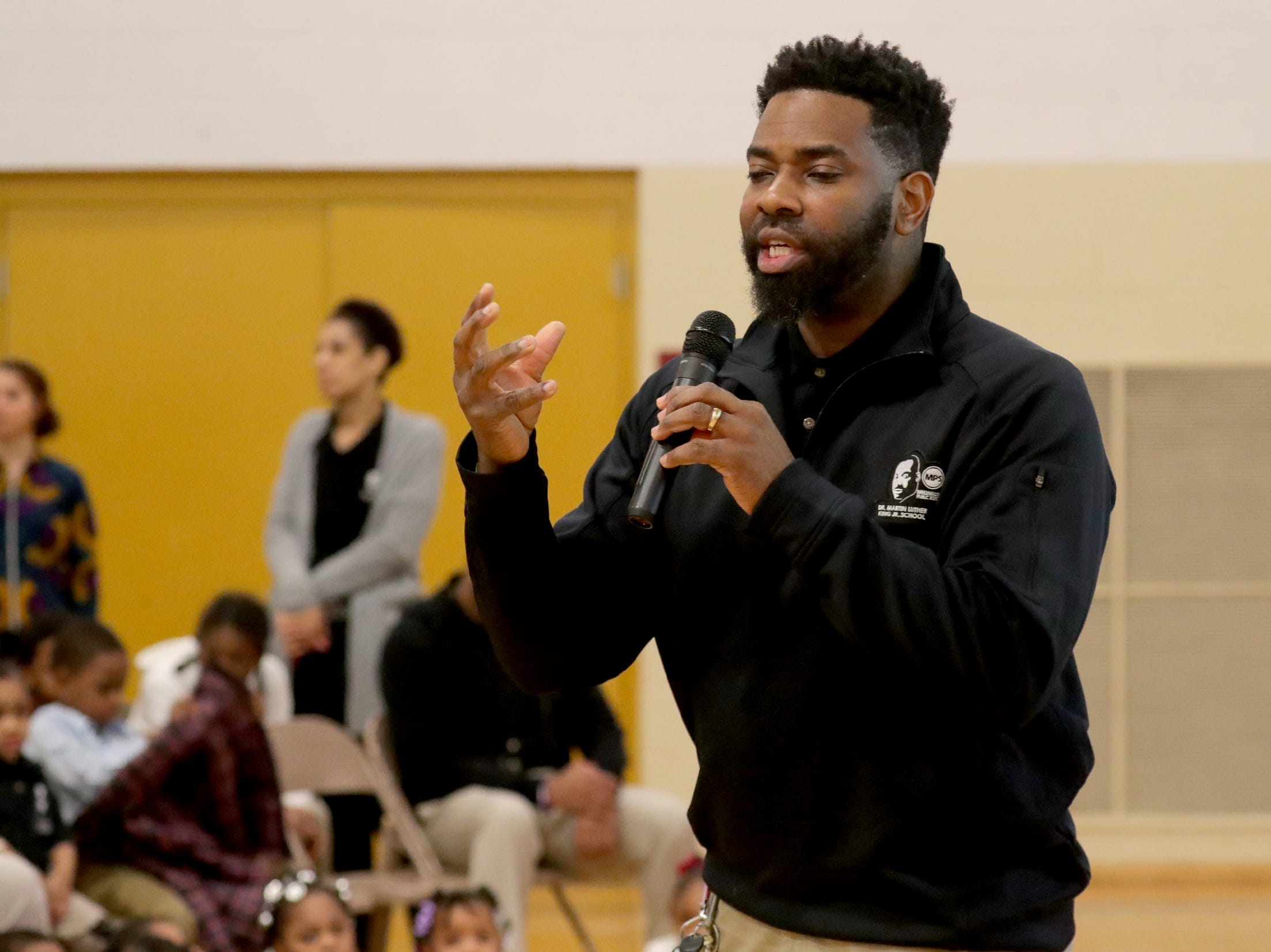 Principal Marcus Arrington speaks during the morning assembly.