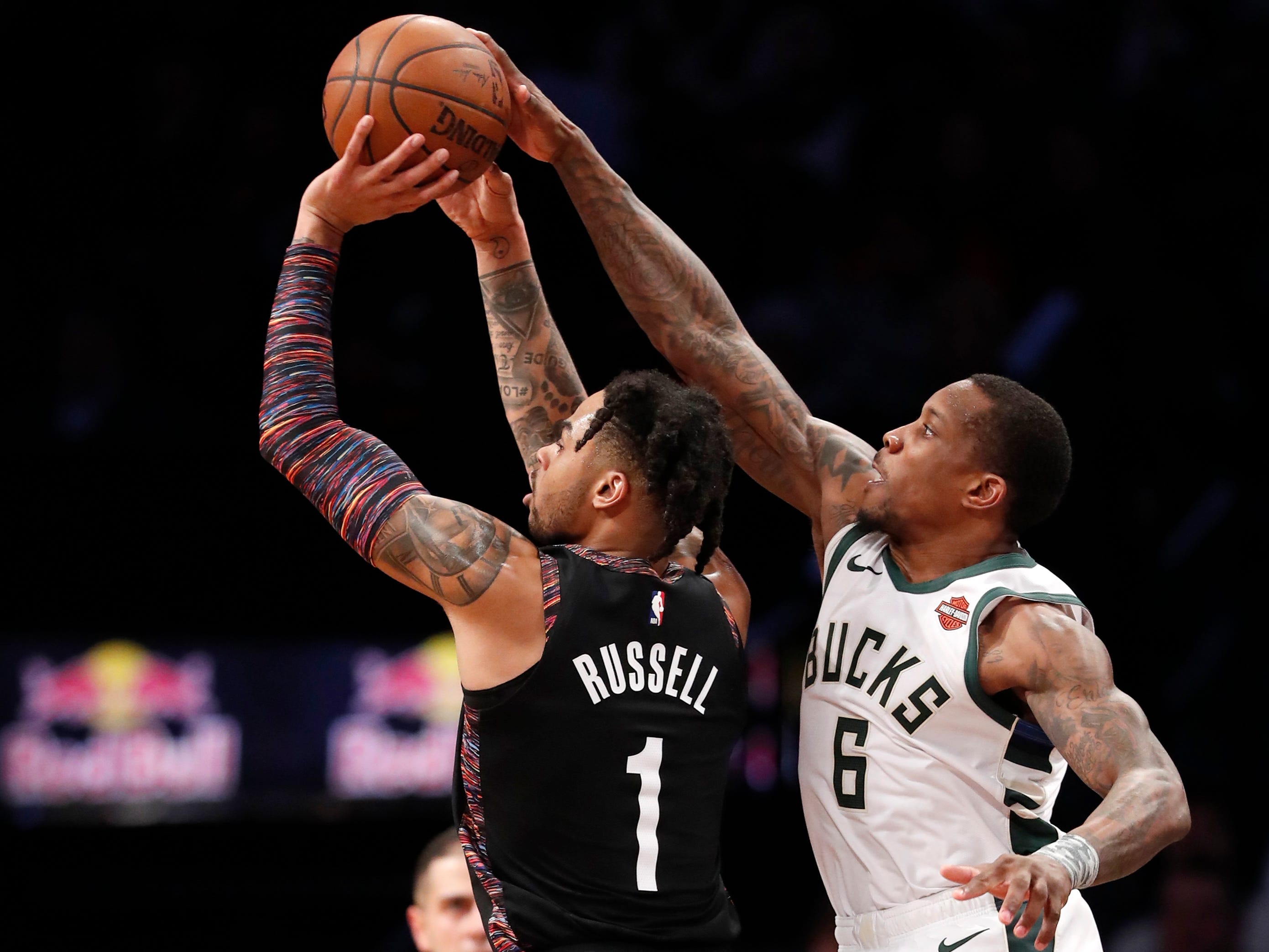 Bucks guard Eric Bledsoe blocks the three-point attempt of the Nets' D'Angelo Russell from behind during the second half Monday night.