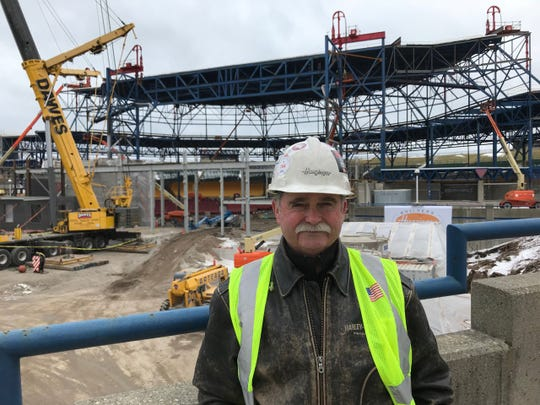 Joel Becker, Vice President of field operations for Hunzinger Construction Co., stands near the renovation of the roof of the American Family Insurance Amphitheater at Summerfest.