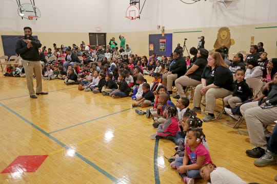 Principal Marcus Arrington speaks during the all-school Mbongi, or morning meeting, at Martin Luther King Jr. elementary school in Milwaukee Monday to kick off national Black Lives Matter in School week.