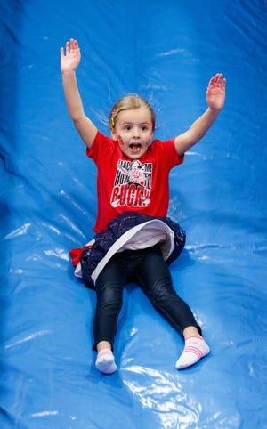 Olivia Thompson of Sussex zips down the giant inflatable slide during the 2016 Family Fun Fair at Zion Lutheran School. This year's fair is Saturday, Feb. 16.
