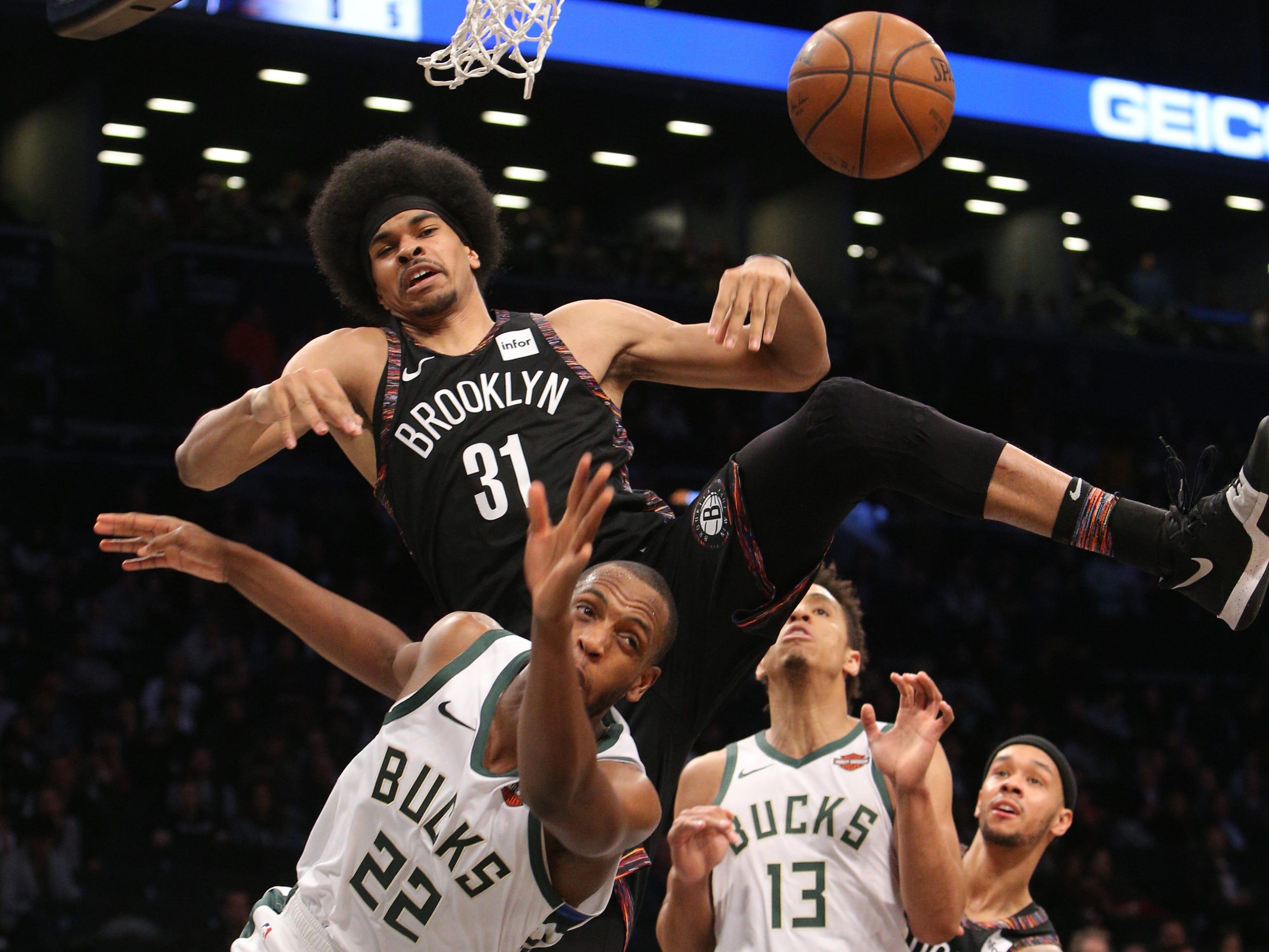 Nets center Jarrett Allen blocks a shot taken by Bucks forward Khris Middleton during the third quarter Monday.