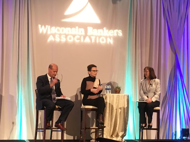 Jelena McWilliams (center), chairman of the FDIC, takes questions from Dave Werner, chief executive of Milwaukee's Park Bank, and Rose Oswald Poels, CEO of the Wisconsin Bankers Association, Tuesday at the trade group's annual Bank Executives Conference in Milwaukee.