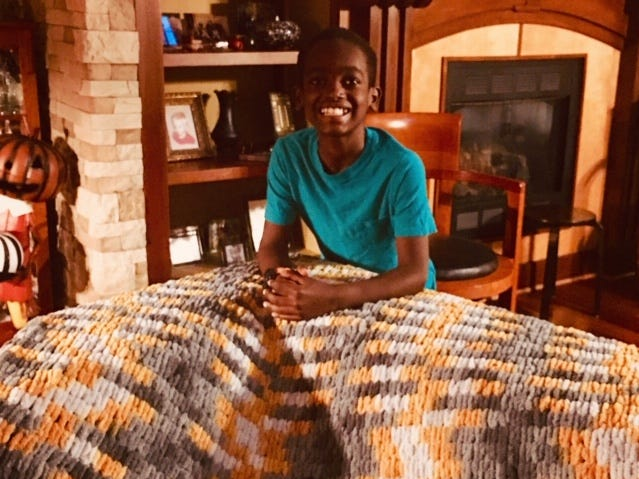 Jonah Larson crocheted this yellow afghan.