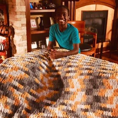 Jonah Larson crocheted this yellow afghan.