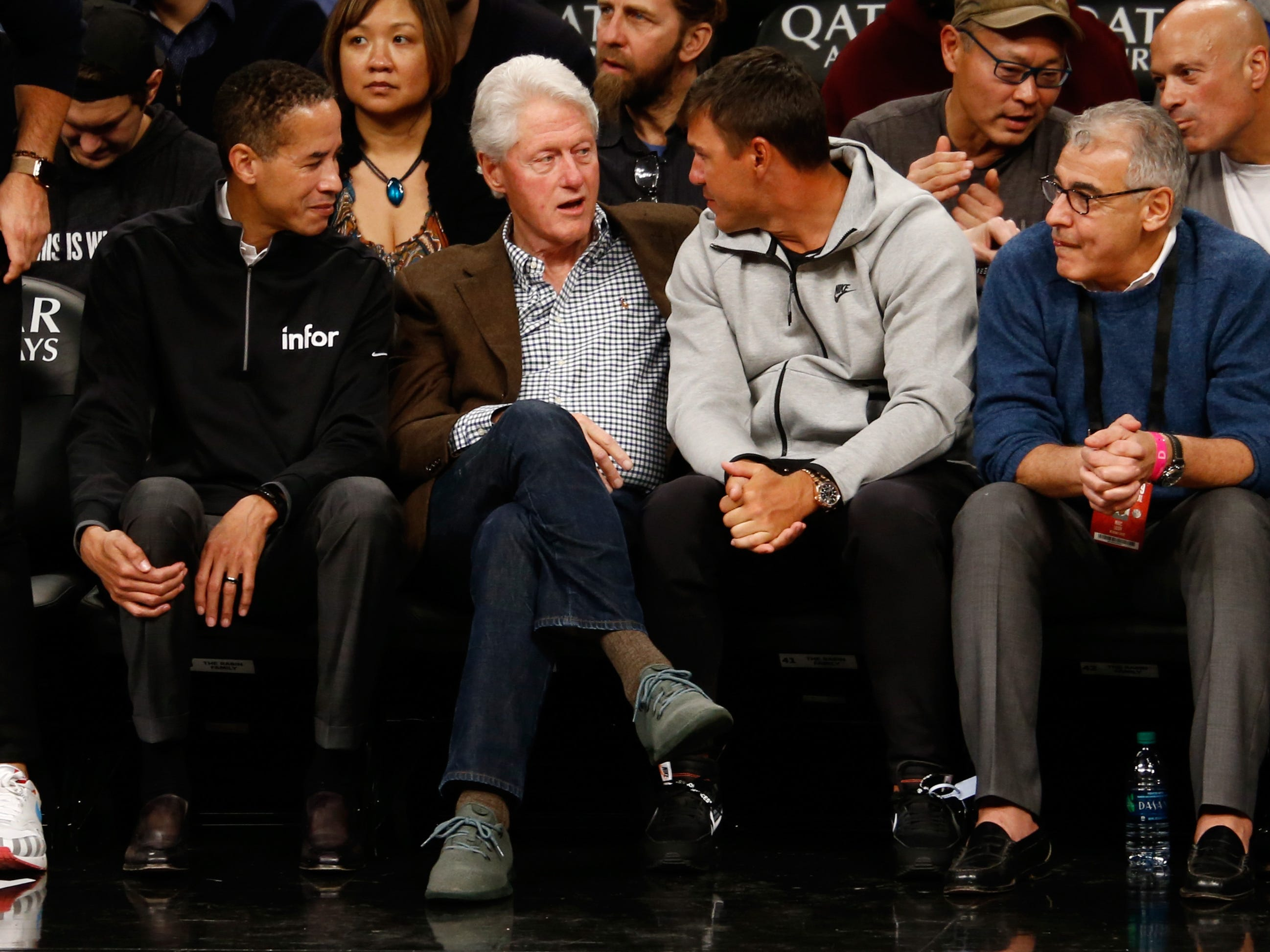 Charles Phillips (from left), CEO of Infor; former president Bill Clinton; reigning PGA Championship winner and two-time U.S. Open champ Brooks Koepka; and Marc Lasry, one of the Bucks principal owners, take in Milwaukee game against the Nets on Monday night at Barclays Center in Brooklyn, N.Y.