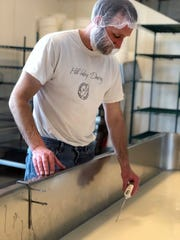 Ron Henningfeld makes cheddar for his Lake Geneva-based Hill Valley Dairy at Clock Shadow Creamery in Walker's Point.