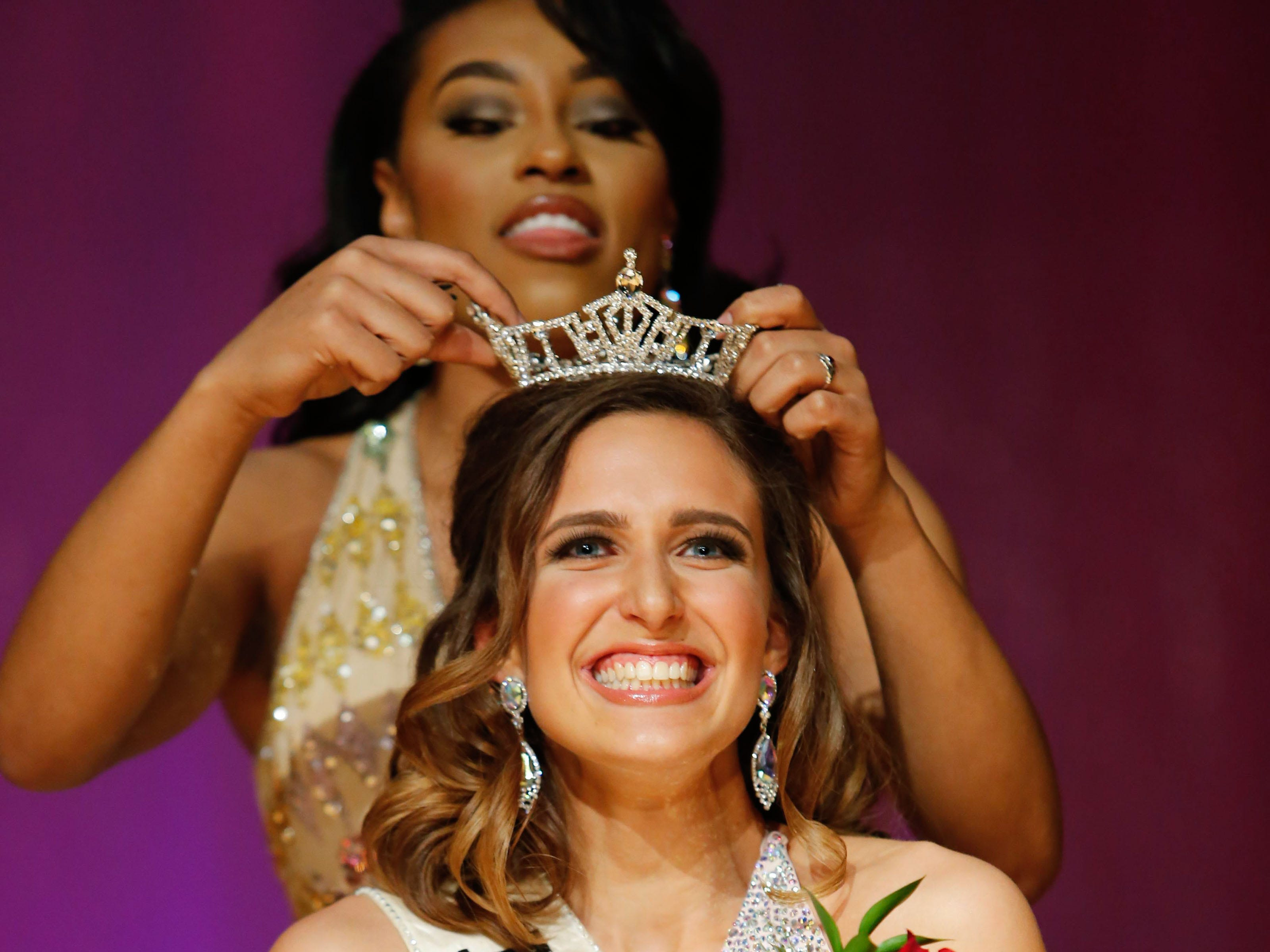 Sarah Bittner is crowned Miss St. Francis 2019 by Alexa Biami (Miss St. Francis 2018) during the 55th annual Miss St. Francis Scholarship Competition at St. Thomas More High School on Saturday, Feb. 2, 2019.