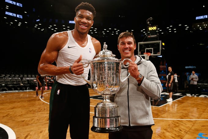 Bucks forward Giannis Antetokounmpo and reigning PGA Championship winner Brooks Koepka pose with the Wanamaker Trophy the golfer won last August at Bellerive CC in St. Louis. Koepka is also the two-time defending U.S. Open champion with the first of his two titles coming at Erin Hills