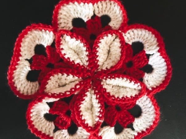 Jonah Larson's crocheted creations are also decorative, like this flower.