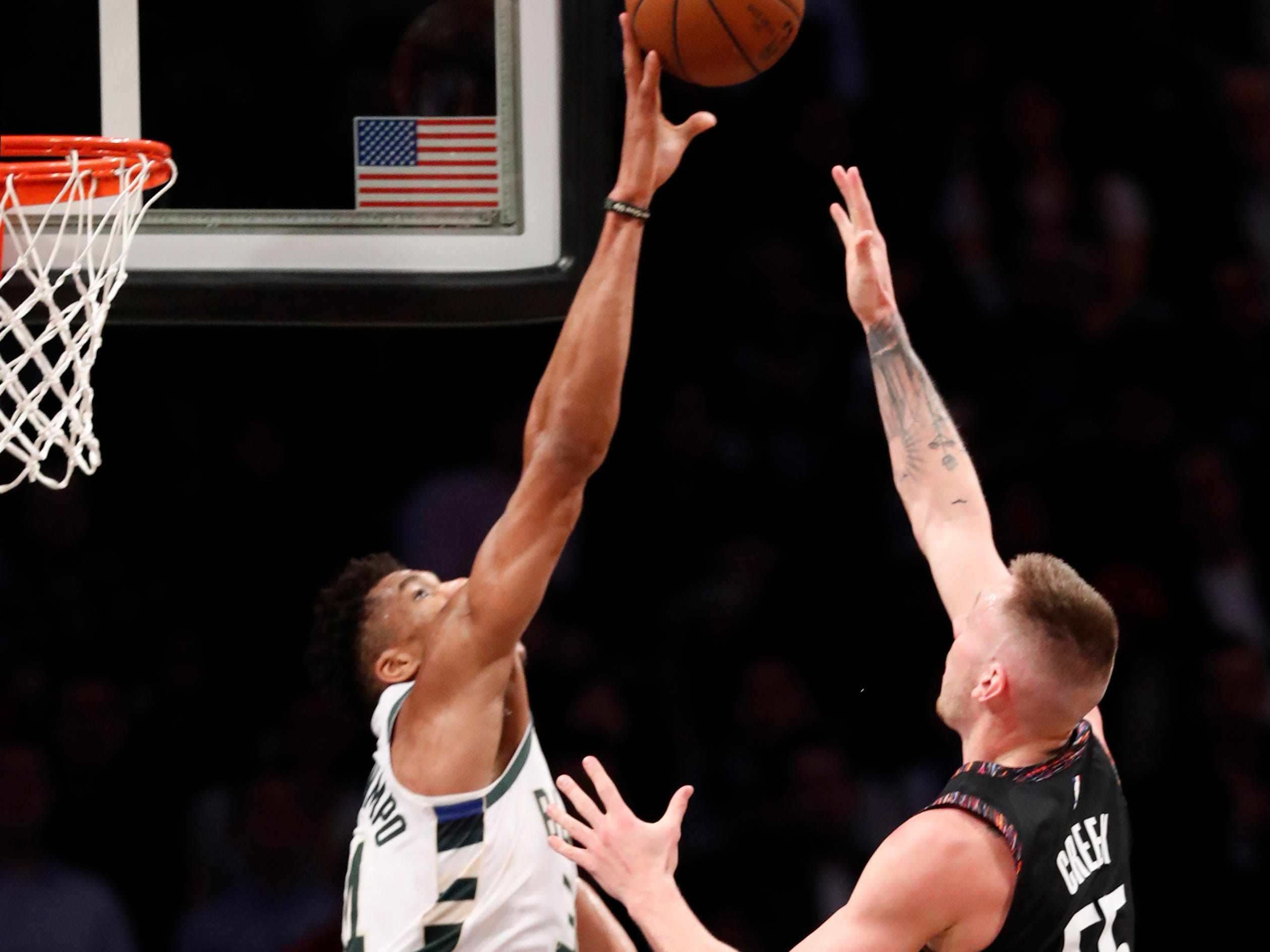 Bucks forward Giannis Antetokounmpo rejects the shot of Nets forward Mitchell Creek during the fourth quarter Monday night.
