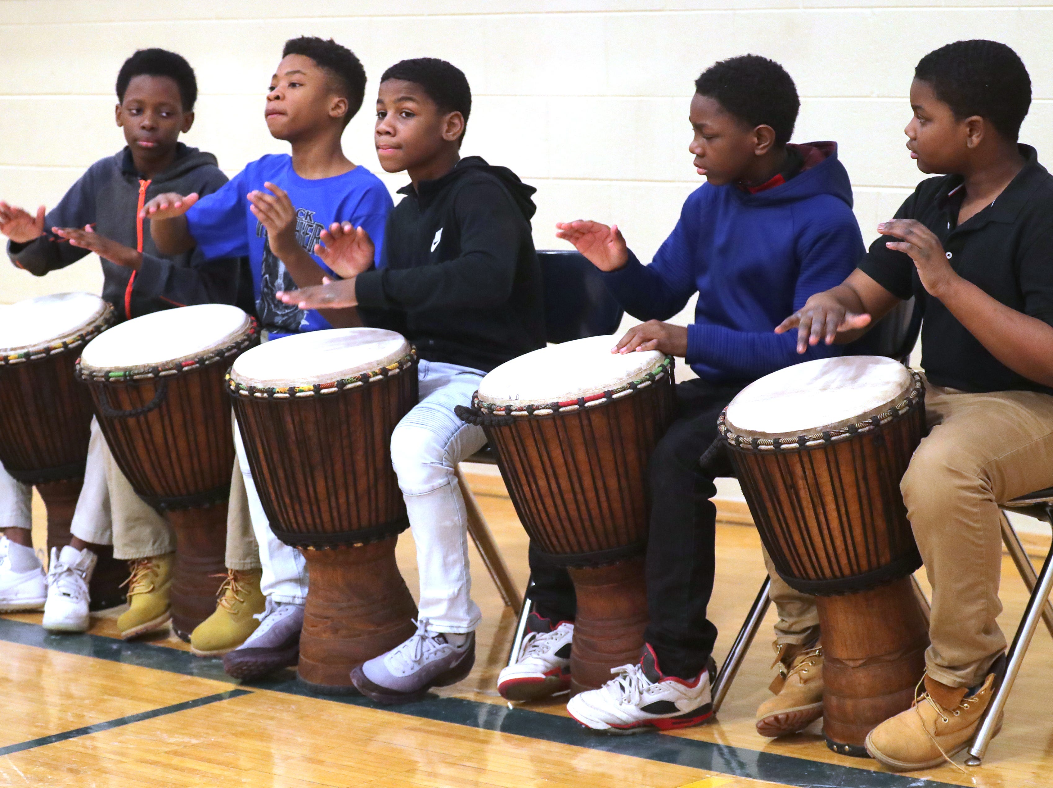 Dr. Martin Luther King Jr. Elementary sixth-graders play drums during an all-school morning assembly called a Mbongi.