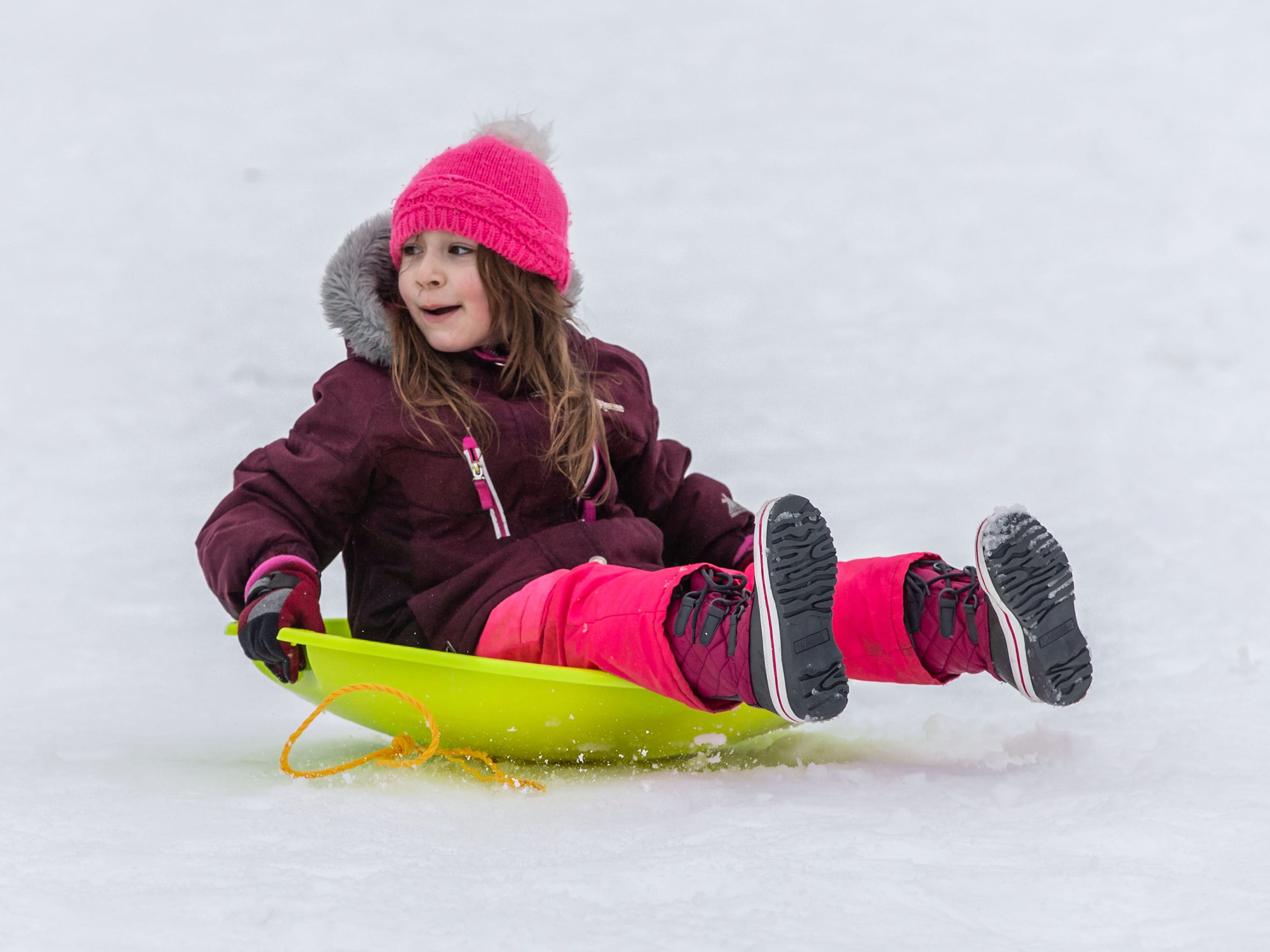 Joslin Albiter, 6, of Lannon zips down the hill backwards during the annual sledding party in Sussex Village Park on Saturday, Feb. 2, 2019. The family-friendly event, hosted by the Sussex Parks & Recreation Department, features sledding, music, crafts, refreshments and a snowman contest.