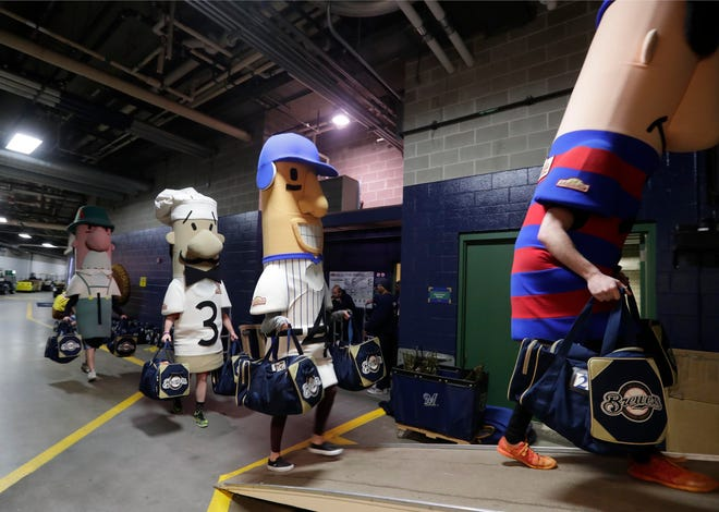 The racing sausages help load baseball gear from the clubhouse to a waiting semi-trailer at Miller Park.