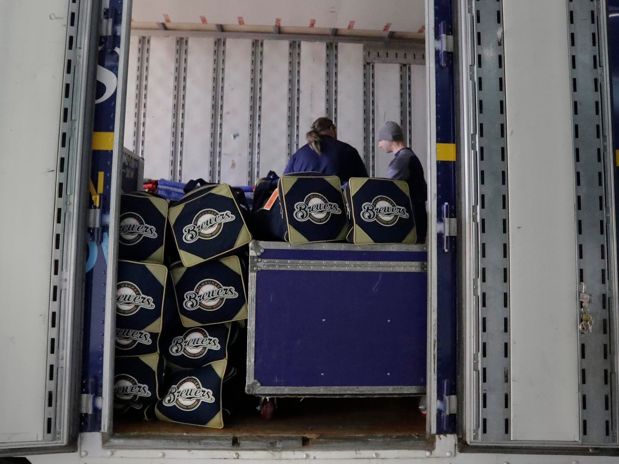 The show is going on the road as clubhouse workers stack bags and make room in the semi-trailer headed from Miller Park to spring training in Phoenix.