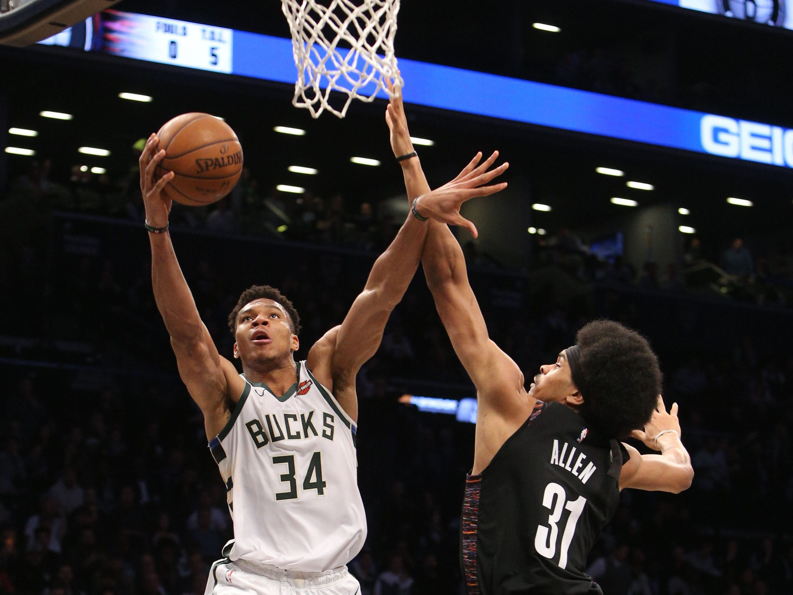 Bucks forward Giannis Antetokounmpo fends off Nets center and shot blocker extraordinaire Jarrett Allen as he goes in for a layup during the third quarter Monday.