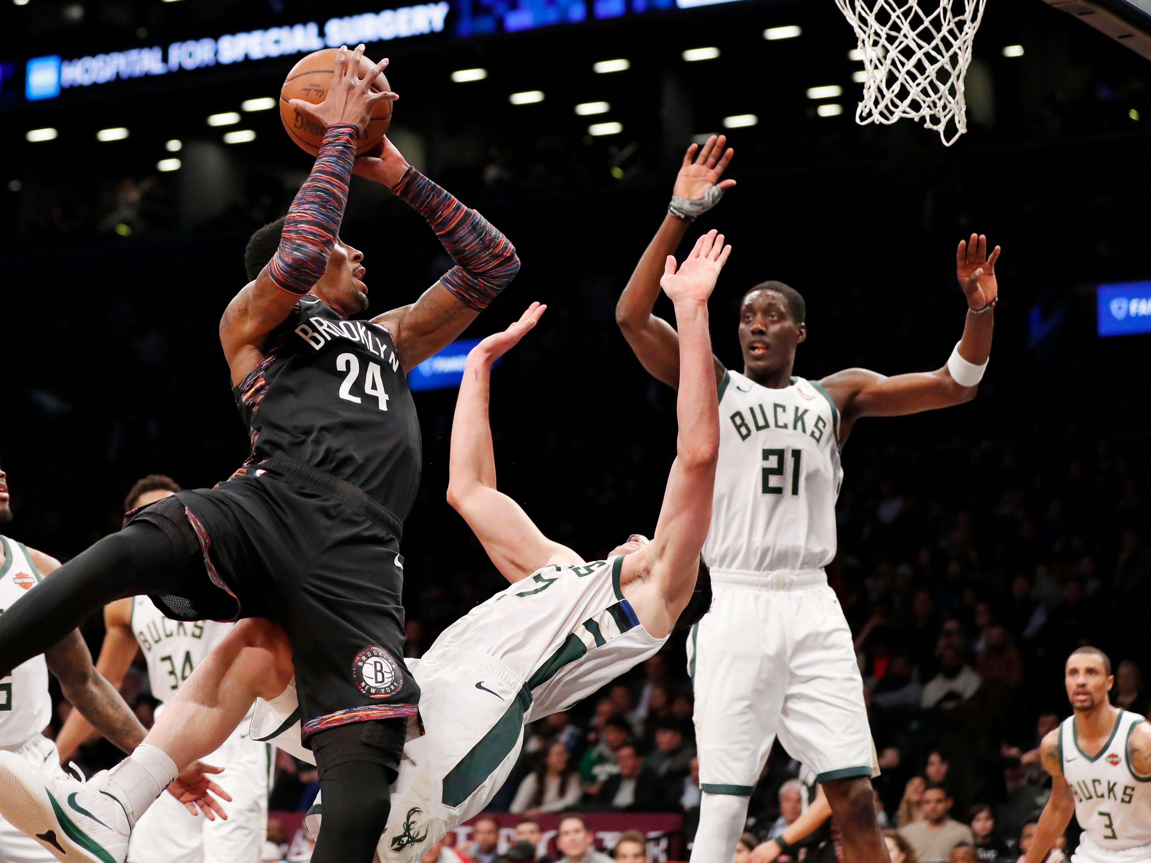 Bucks forward Ersan Ilyasova draws a charging foul on the Nets' Rondae Hollis-Jefferson during the first half Monday night.