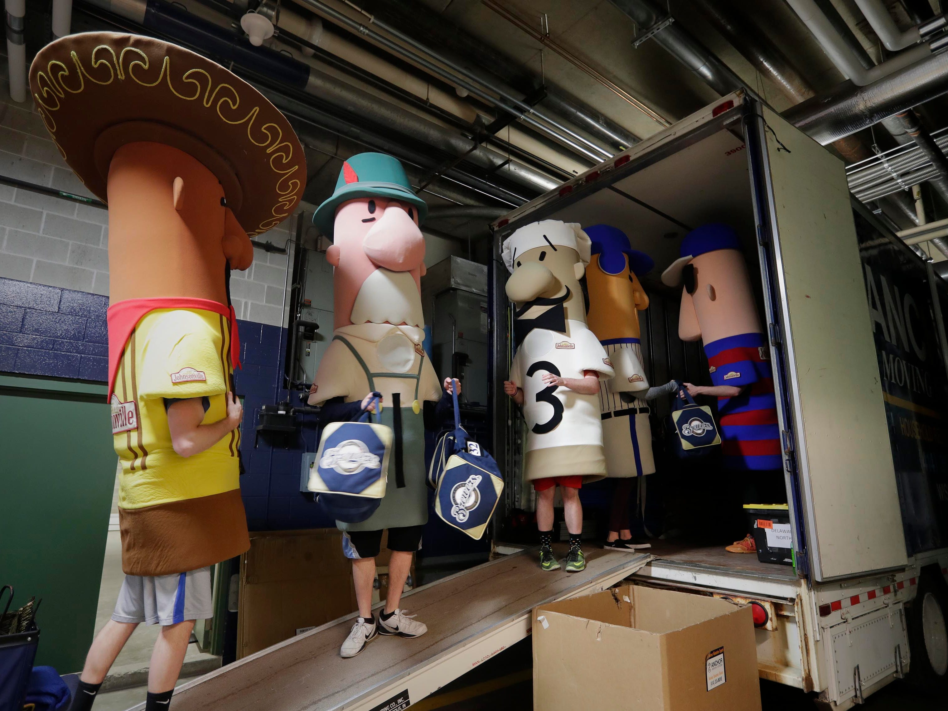 The Racing Sausages help load baseball gear from the clubhouse to a waiting semi-trailer at Miller Park as the Milwaukee Brewers load up their truck for spring training. Pitchers and catchers are scheduled to report to Phoenix on Feb. 13. position players report on Feb. 18.