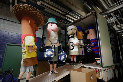 The Racing Sausages Help Load Baseball Gear From Clubhouse To A Waiting Semi Trailer