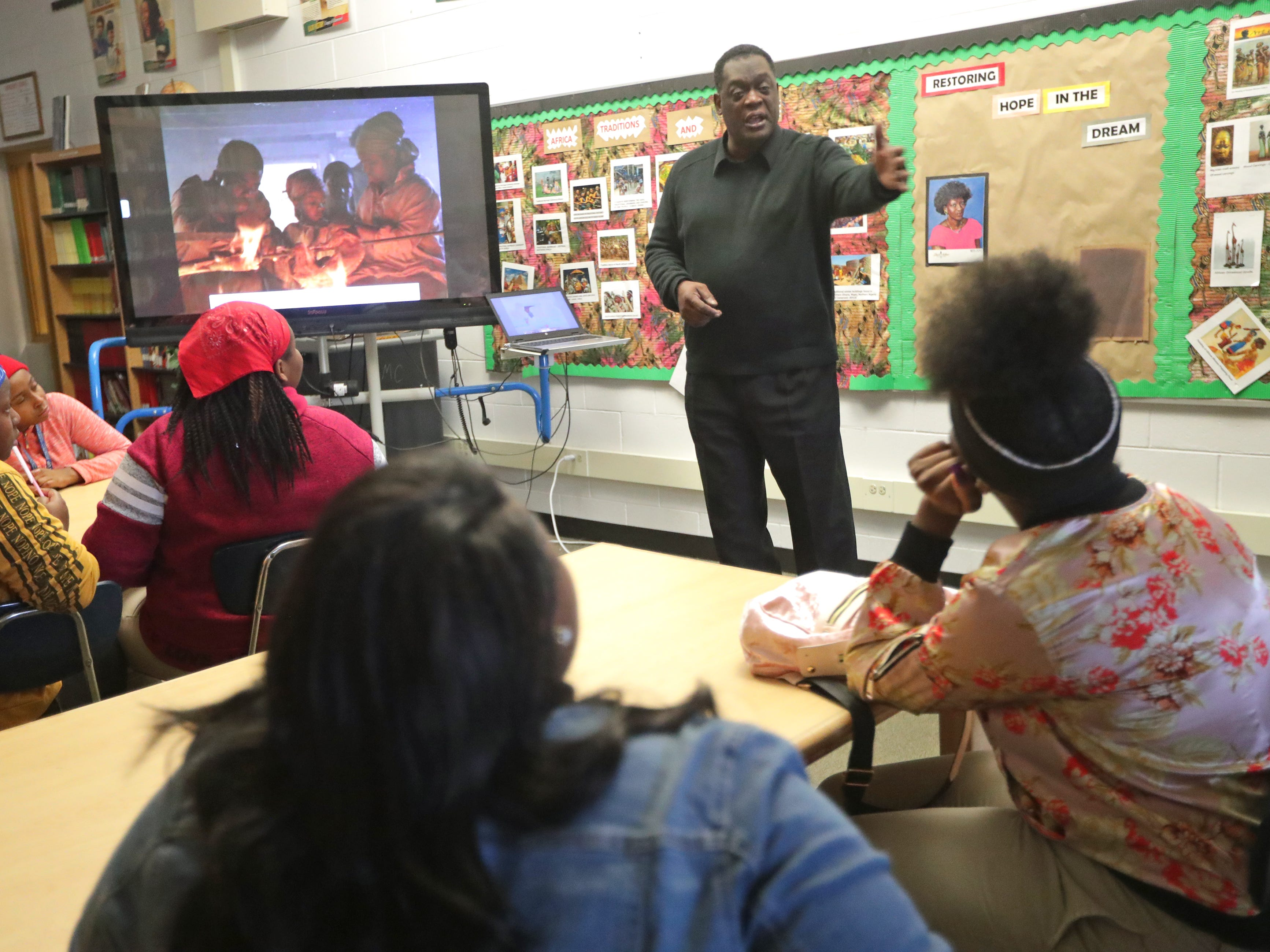 Jerome Johnson, library specialist at Dr. Martin Luther King Jr. Elementary school, speaks to eighth-graders about the history of the equal rights movement for African-Americans in the United States.