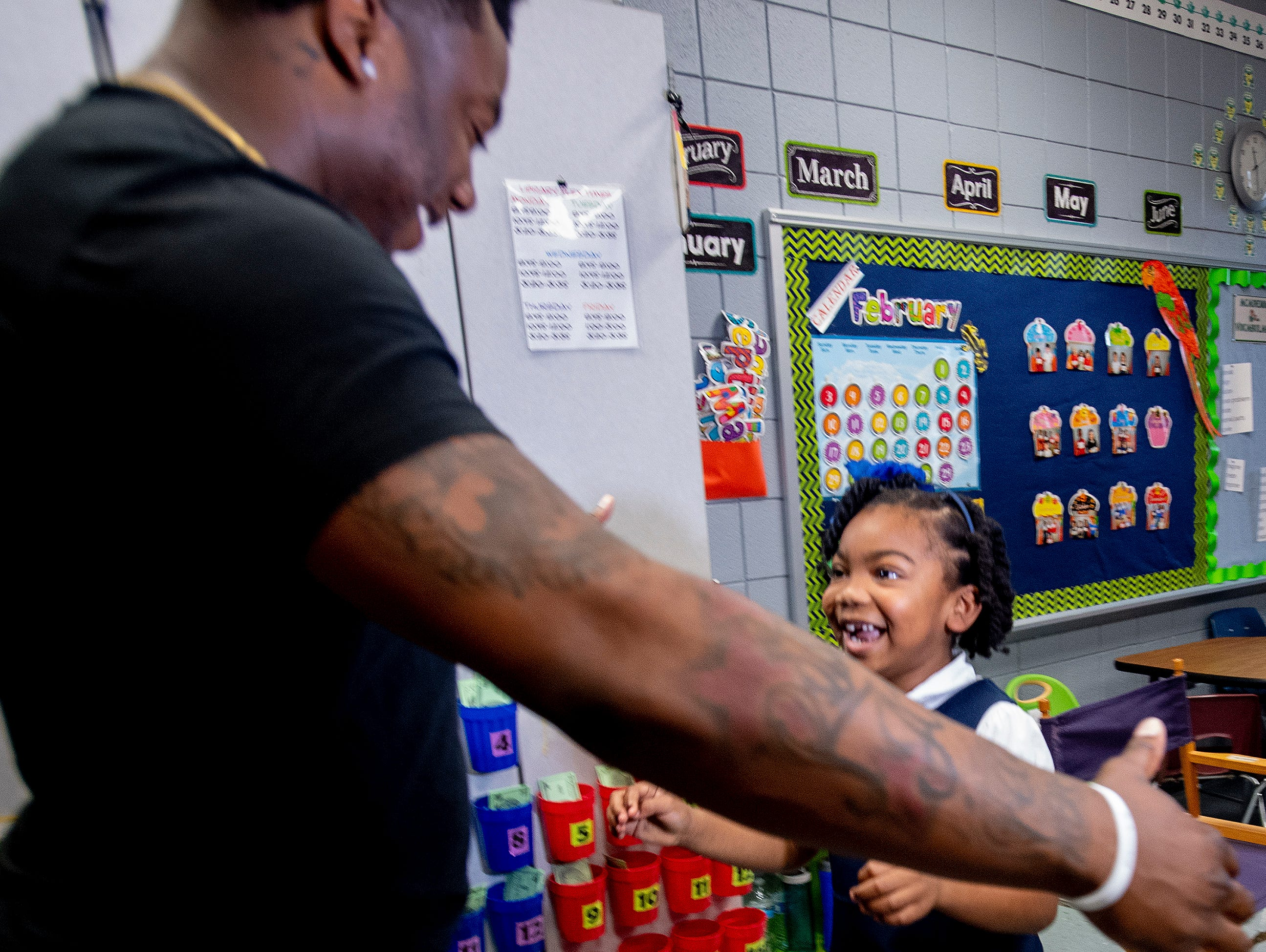 Kirk Jay, who finished third on The Voice, greets his biggest little fan McKenzie Ogletree as he visits pupils at Forest Avenue School in Montgomery, Ala., on Tuesday February 5, 2019.