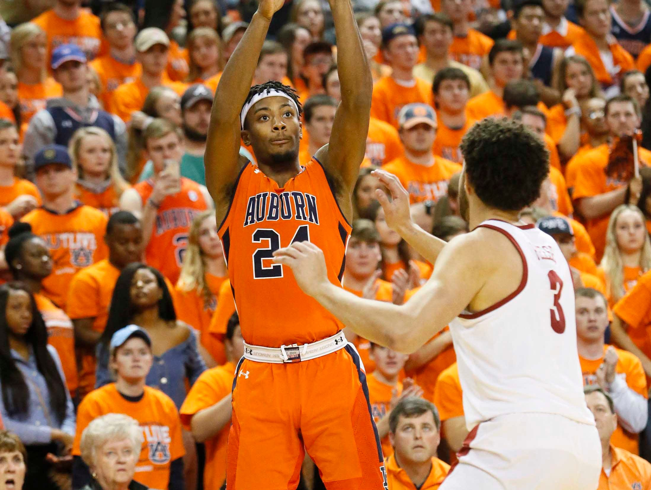 Feb 2, 2019; Auburn, AL, USA; Auburn Tigers forward Anfernee McLemore (24) takes a shot over Alabama Crimson Tide forward Alex Reese (3) during the second half at Auburn Arena. Mandatory Credit: John Reed-USA TODAY Sports