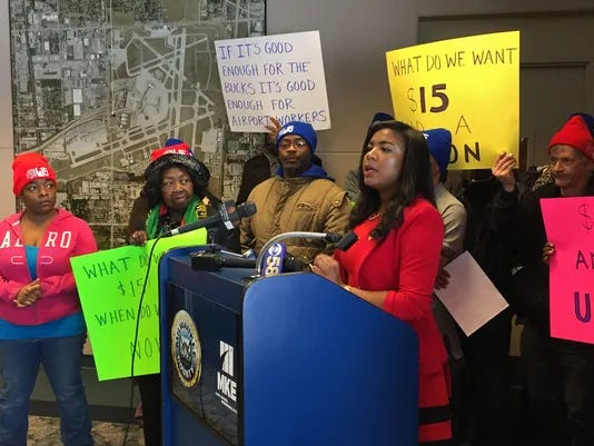 Backed by supporters of a $15-an-hour minimum wage, Milwaukee County Supervisor Marcelia Nicholson called Monday for workers at Mitchell International Airport to be covered by an agreement similar to that being implemented at the Milwaukee Bucks arena and adjacent entertainment district. Nicholson spoke at a news conference at the airport.
