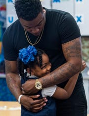 Kirk Jay, who finished third on The Voice, hugs his biggest little fan McKenzie Ogletree as he visits pupils at Forest Avenue School in Montgomery, Ala., on Tuesday February 5, 2019.