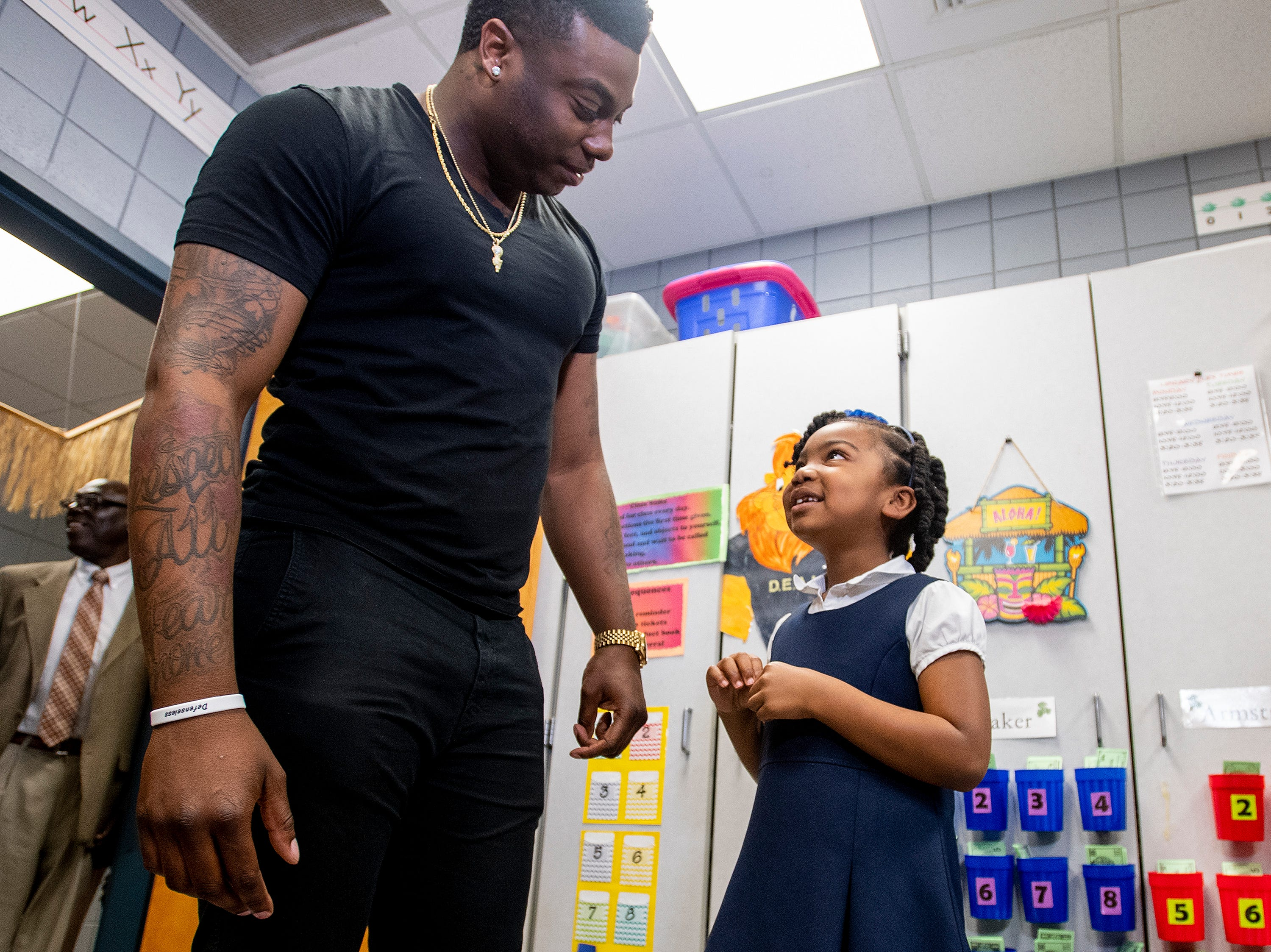 Kirk Jay, who finished third on The Voice, talks with fan McKenzie Ogletree as he visits Forest Avenue School in Montgomery, Ala., on Tuesday February 5, 2019.