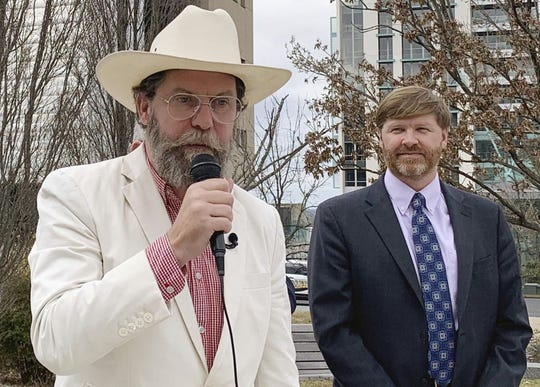 Proud Boys founder Gavin McInnes, left, discusses a lawsuit he filed against the Southern Poverty Law Center during a news conference in Montgomery, Ala., on Monday, Feb. 4, 2019. His attorney, Baron Coleman, listens on the right.