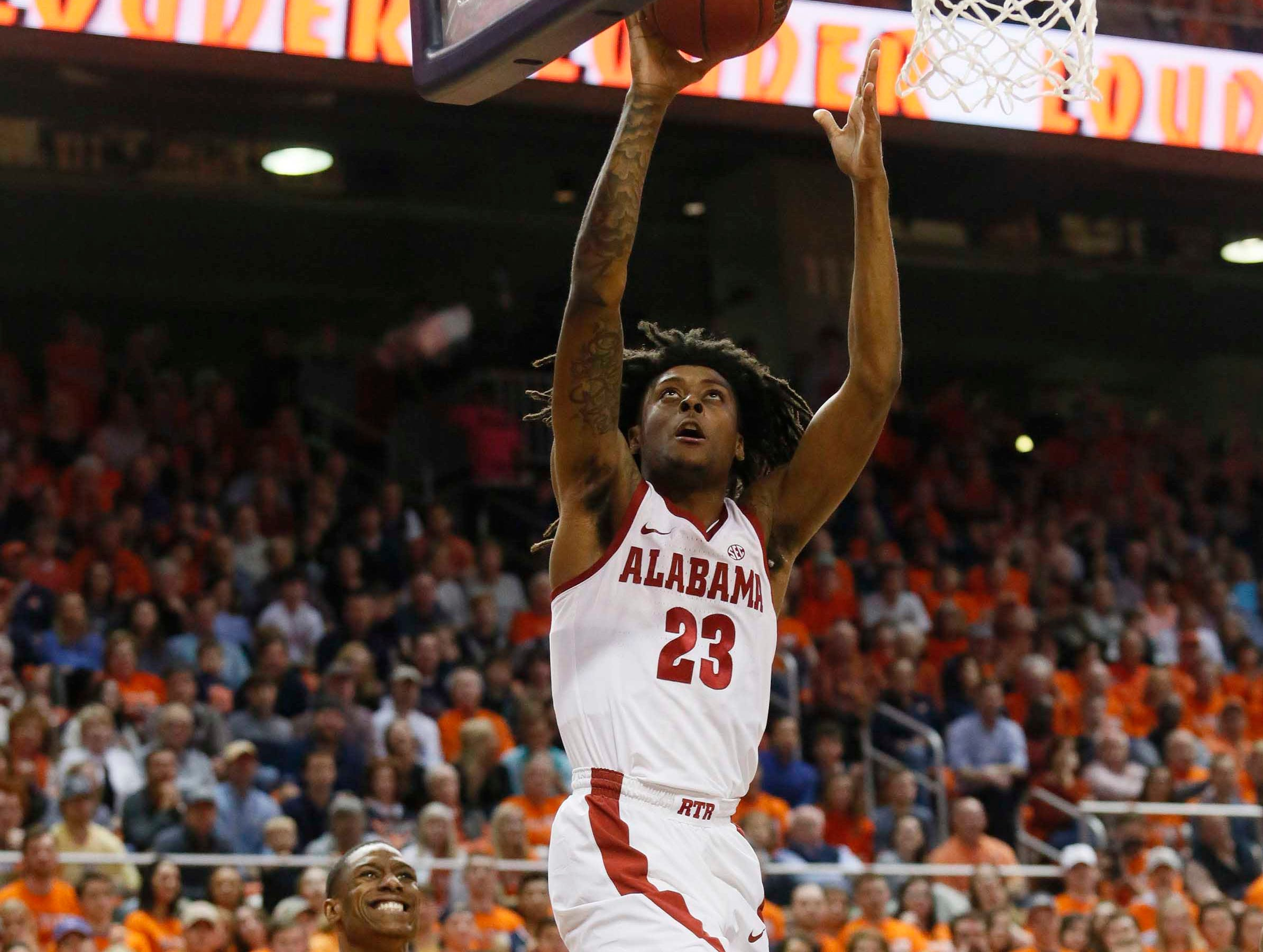 Feb 2, 2019; Auburn, AL, USA; Alabama Crimson Tide guard John Petty (23) takes a shot against the Auburn Tigers during the first half at Auburn Arena. Mandatory Credit: John Reed-USA TODAY Sports