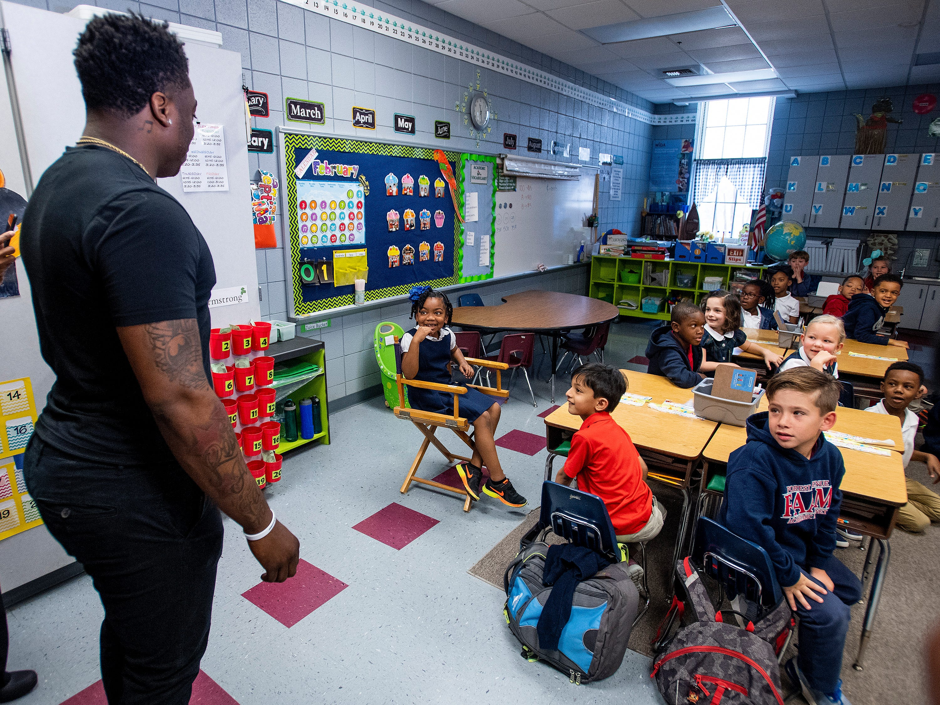 Kirk Jay, who finished third on The Voice, greets fan McKenzie Ogletree as he visits Forest Avenue School in Montgomery, Ala., on Tuesday February 5, 2019.